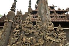 Carved wooden statue at Shwenandaw Kyaung Temple, Mandalay, Myan Stock Photo