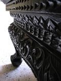 Carved Wooden Table. The leg and side of a carved wooden table royalty free stock photos