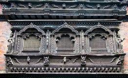 Carved wooden window on Bhaktapur palace, Kathmandu valley,  Nep Stock Photo