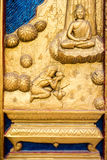 Carved wooden window. Carved wood of buddha mythical on temple window Stock Photos
