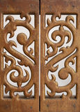 Carved wooden work. Carved wooden lattice work with Thai style pattern art in Thailand Royalty Free Stock Photography