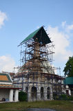 Carver restore and repair chedi at Wat Thepthidaramvaraviharn Temple in Bangkok Thailand. Wat Thepthidaram was built by King Rama III in 1836 for his daughter Royalty Free Stock Photos