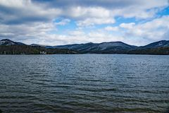 Carvin Cove Reservoir with a Snowy background of Bushy Mountain. Carvin Cove Reservoir with a snowy background of Busht Mountain located in Botetourt County Stock Photo