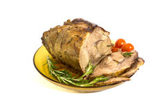 Carving baked pork. Isolated on white Royalty Free Stock Photography