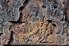 Carving in Banteay Srei. A pediment shows Ravana shaking Mount Kailasa Stock Images