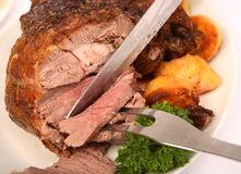 Carving boneless lamb Stock Images