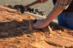 Carving Canoe 1. Hands and tools of a man in process of carving indian canoe royalty free stock photo