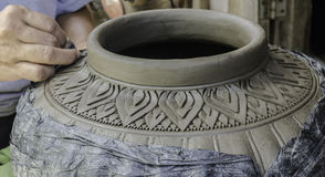 Carving clay for make earthenware. Royalty Free Stock Image