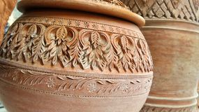 Carving on clay water jar Stock Photo
