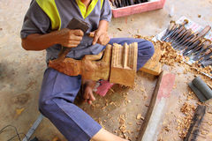 Carving craftsman is carving wood for Buddha model Stock Image