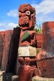 Maori wood carving of a small human figure. Rotorua, New Zealand royalty free stock image