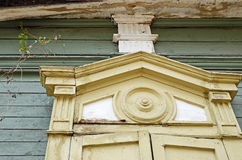 The carving decorative element of window of the wooden house. Irkutsk streets, Russia Stock Image