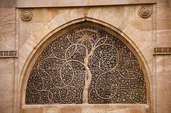 Carving details on the outer wall of the Sidi Sayeed Ki Jaali Mosque, Built in 1573, Ahmedabad, Gujarat stock photography