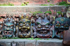 Carving Devil Mask nepal style at Kathmandu. Durbar Square is the generic name used to describe plazas and areas opposite the old royal palaces in Nepal. It Stock Image