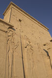 Carving of Egyptian god on pylon. In Temple of Isis at Philae, Egypt stock photos