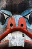 carving face on a totem pole Royalty Free Stock Image