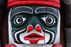 Carving face on a totem pole Royalty Free Stock Images