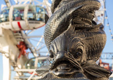 Carving of fish on riverbank by London Eye Royalty Free Stock Images