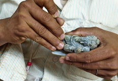 Carving god on stone. A craftsman carving the stone to shape indian god Stock Image