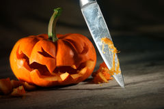 Carving a Halloween jack o' lantern Stock Photos