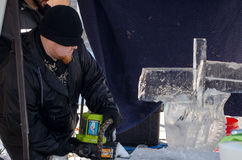 Carving ice with saw Royalty Free Stock Photo