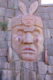 Carving of Inca warrior on a wall in Chivay town, Peru. Chivay is the capital of Caylloma province royalty free stock image