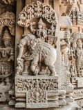 Carving of Indra. A carving of the Hindu god Indra sitting on his elephant at t the 13th Century temple of Somanathapur, Karnataka, South India stock photo