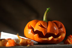 Carving a jack o' lantern Stock Images