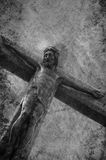Carving of Jesus on cross. Low angle view of carving of Jesus Christ crucified on cross Stock Photos
