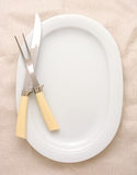 Carving Knife and Fork on Platter Stock Photos