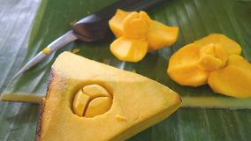 Carving knife and yellow pumpkin on banana leaf Stock Images