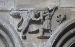 Carving of knight fighting lion inside English Cathedral church Stock Photography