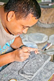 Carving mani stones in Kathmandu, Nepal. Stock Photo