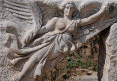 Carving of Nike. A carving of goddess of victory Nike in ancient city of Ephesus which supposedly used to be a ceiling fragment Royalty Free Stock Images