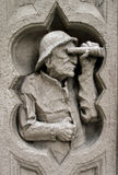 Carving of an old man on a building Royalty Free Stock Photography