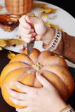Carving out a pumpkin to prepare halloween lantern Royalty Free Stock Photo