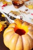 Carving out a pumpkin to prepare halloween lantern Stock Photos