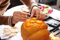 Carving out a pumpkin to prepare halloween lantern Stock Image