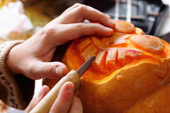 Carving out a pumpkin to prepare halloween lantern Stock Photo