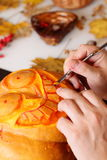 Carving out a pumpkin to prepare halloween lantern Royalty Free Stock Images