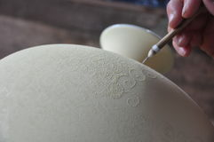Carving picture and pattern on Porcelain vase - Jingdezhen - Jiangxi Province - China. Artist is carving picture and pattern on a raw Porcelain vase inside a Stock Photos