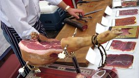 Carving pork meat. smoked pork. meat at the market Royalty Free Stock Photos