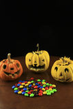 Carving pumpkin  and candy. Stock Images