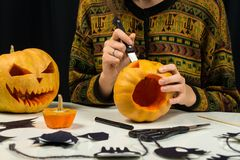 Carving pumpkin for jack`o`lantern face stock photography
