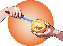 Carving a pumpkin with knife hands for Halloween Stock Image