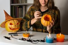 Carving pumpkins for halloween at home stock photo