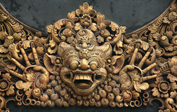 Carving at Pura. Hundreds years old carving at Pura in Bali, Indonesia Royalty Free Stock Photography