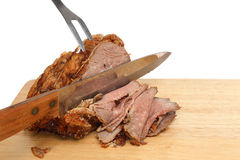 Carving roast beef Royalty Free Stock Photography