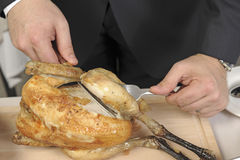 Carving a roast chicken Royalty Free Stock Photography