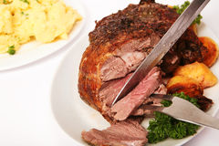 Carving roast leg of lamb Stock Images